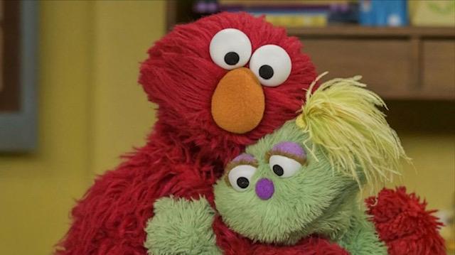 Elmo hugging Karli