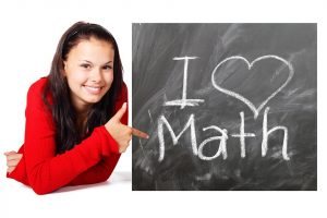 young girl with sign that says i love math