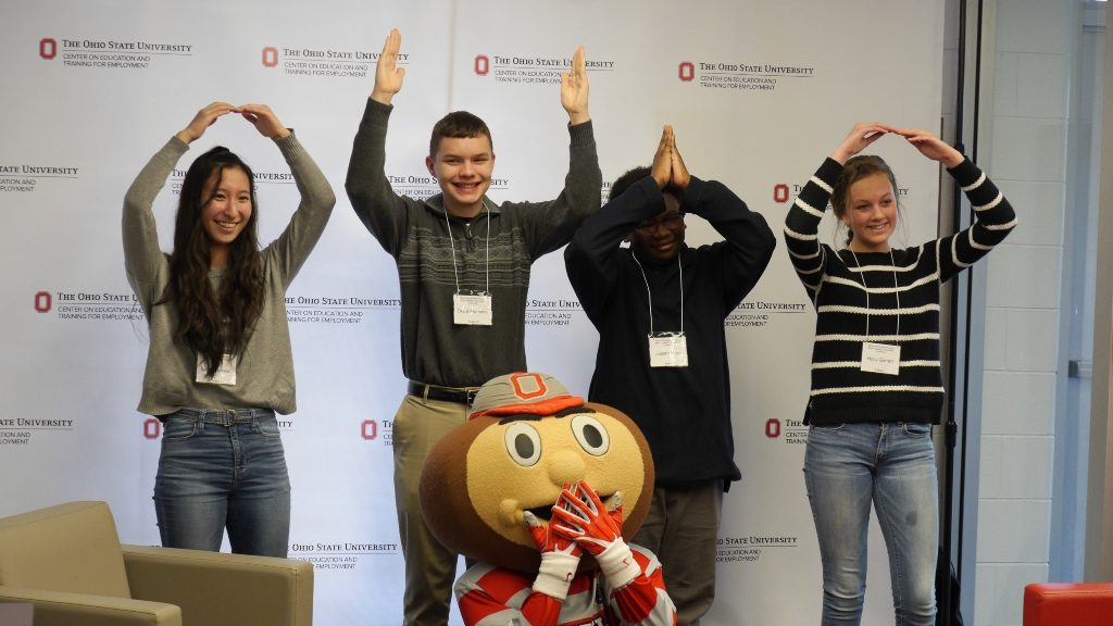Middle and High School Council Members spelling out OHIO with their bodies and posing with Brutus Buckeye in February 2019