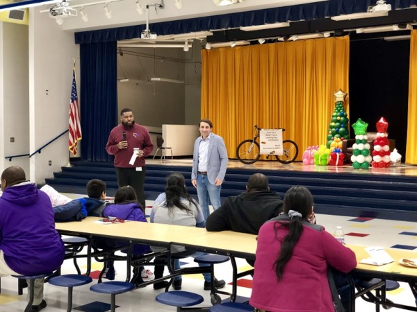 Picture of Roberts Paideia Principal Alpacino Beauchamp and Roberts Welcome Center Director Antonio Fernandez address the parents at the beginning of the conference.