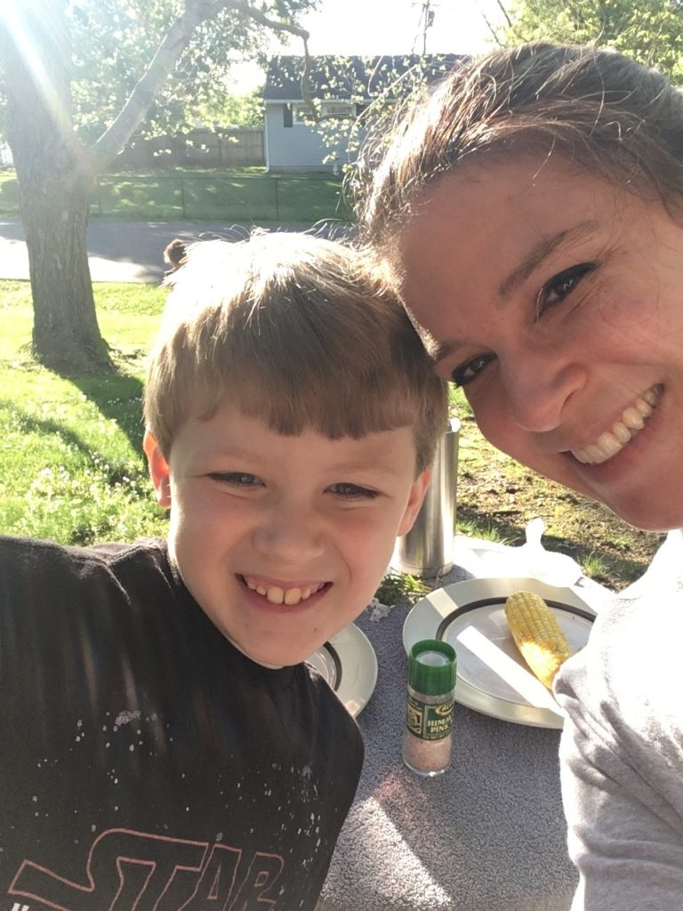 Image of Hunter (L) & mom Bess (R) smiling at the camera