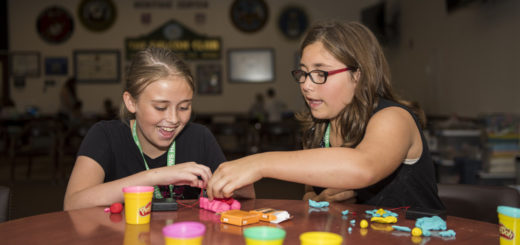 two girls playing with play dough