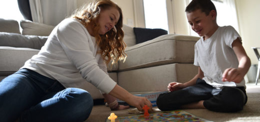 parent and child playing board game