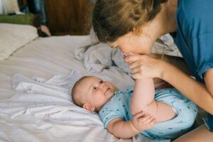 mom kissing baby's feet