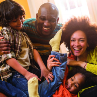 Photo of black dad, mom, young girl, and young boy