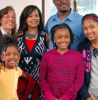 a black family with three children and three adults