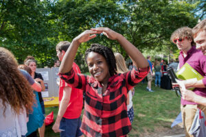 College student outside creating 'O' from Ohio with her arms