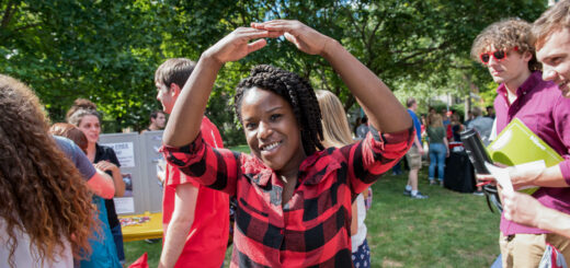 Black college student outside creating 'O' from Ohio with her arms