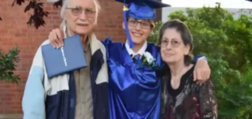 graduation picture of white student with their grandparents